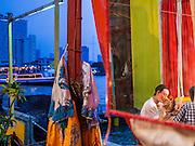 """26 NOVEMBER 2014 - BANGKOK, THAILAND: A performer puts on her makeup before a Chinese opera performance at the Chow Su Kong Shrine in the Talat Noi neighborhood of Bangkok. Chinese opera was once very popular in Thailand, where it is called """"Ngiew."""" It is usually performed in the Teochew language. Millions of Chinese emigrated to Thailand (then Siam) in the 18th and 19th centuries and brought their culture with them. Recently the popularity of ngiew has faded as people turn to performances of opera on DVD or movies. There are about 30 Chinese opera troupes left in Bangkok and its environs. They are especially busy during Chinese New Year and Chinese holidays when they travel from Chinese temple to Chinese temple performing on stages they put up in streets near the temple, sometimes sleeping on hammocks they sling under their stage.      PHOTO BY JACK KURTZ"""