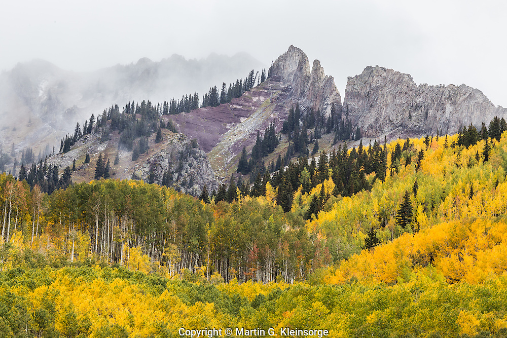 First snowstorm of the autumn season as clouds blow in over The Dyke and the Ruby Range.  Colorado.
