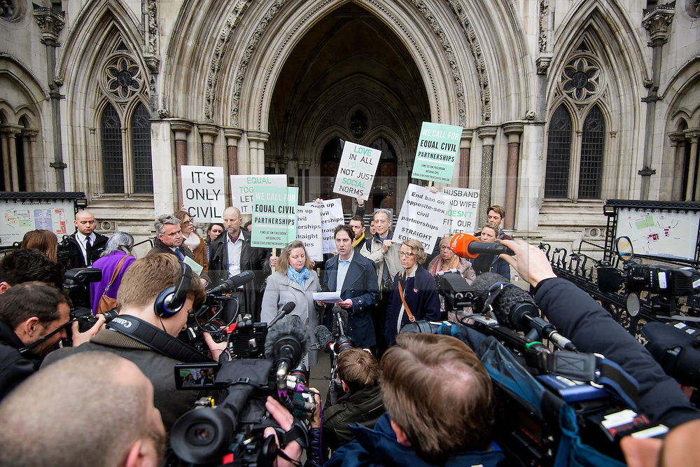 © Licensed to London News Pictures. 21/02/2017. London, UK. Heterosexual couple REBECCA STEINFELD and CHARLES KEIDAN (centre) surrounded by media as they leave the Royal Courts of Justice in London, where a Court of appeal ruled against the heterosexual couple being allowed to enter in to a civil partnership. Photo credit: Ben Cawthra/LNP