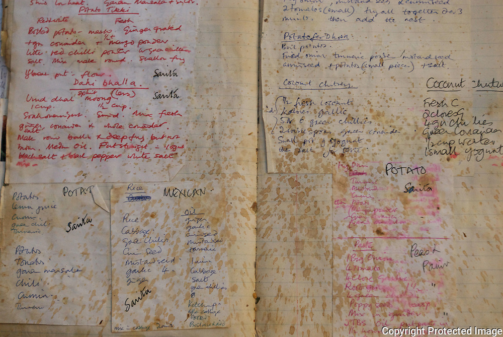 An oil spattered handwritten recipe book.