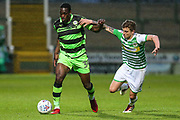 Forest Green Rovers Isaiah Osbourne(34) holds off Yeovil Town's Jared Bird(4) during the EFL Sky Bet League 2 match between Yeovil Town and Forest Green Rovers at Huish Park, Yeovil, England on 24 April 2018. Picture by Shane Healey.