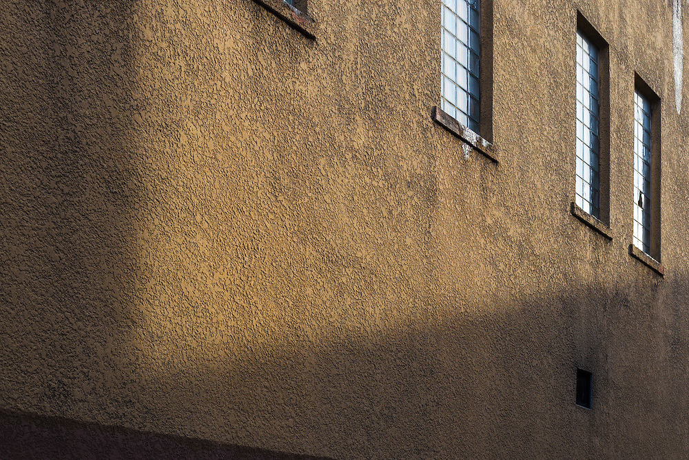 Photograph of late afternoon light on an old urban building.