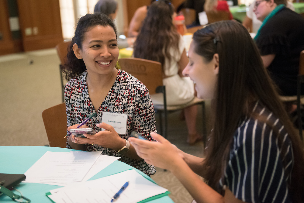 Prabha Shrestha talks with her mentee during the Women's Mentoring Meet and Greet event on Sept. 4, 2018 in Walter Rotunda. Photo by Hannah Ruhoff