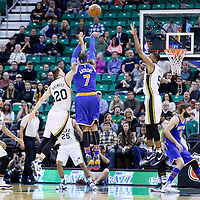 09 December 2015: New York Knicks forward Carmelo Anthony (7) takes a jump shot over Utah Jazz forward Gordon Hayward (20) and Utah Jazz guard Rodney Hood (5) during the Utah Jazz 106-85 victory over the New York Knicks, at the Vivint Smart Home Arena, Salt Lake City, Utah, USA.