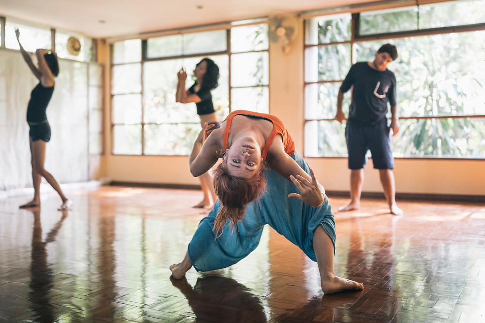 Chiang Mai, Thailand -- May 20, 2017: A woman free-form dancing during a movement class at The Yoga Tree in Chiang Mai, Thailand