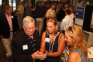 (from left in group) Hans Marlette of Day of Caring, Lori Klens of Market Smart Solutions and Shelagh McGovern of MONCO Secure Document Destruction during a Dayton Area Chamber of Commerce Business After Hours at the NCR Country Club in Kettering, Wednesday, July 25, 2012.  The Chamber will hold the 2012 Chamber Challenge, their 20th annual golf tournament and silent auction, at the NCR Country Club in September.
