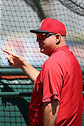 ANAHEIM, CA - APRIL 30:  Mike Scioscia #14 of the Los Angeles Angels of Anaheim points during batting practice before the game against the Cleveland Indians at Angel Stadium on Wednesday, April 30, 2014 in Anaheim, California. The Angels won the game 7-1. (Photo by Paul Spinelli/MLB Photos via Getty Images) *** Local Caption *** Mike Scioscia
