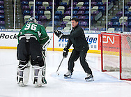 Goaltending coach Scott Meyer (right) talks with RoughRiders goalie Matt McNeely during a practice at the Cedar Rapids Ice Arena, 1100 Rockford Road SW, in Cedar Rapids on Tuesday, December 13, 2011. (Stephen Mally/Freelance)