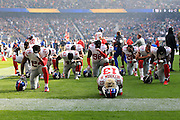 New York Giants pray before kick off during the International Series match between New York Giants and Los Angeles Rams at Twickenham, Richmond, United Kingdom on 23 October 2016. Photo by Jason Brown.