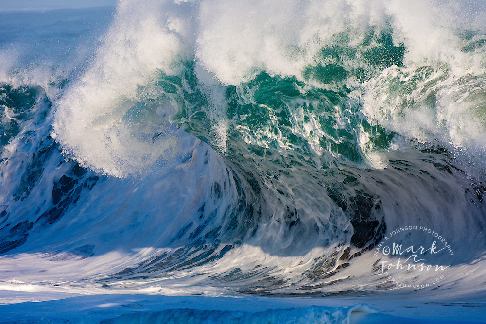 Powerful wave breaking off a Kauai, Hawaii beach