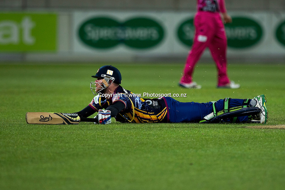 Nicholas Beard of the Volts slides along the ground as he makes the winning run during the Georgie Pie Super Smash Volts v Knights cricket match at the Westpac Stadium in Wellington on Sunday the 23rd of November 2014. Photo by Marty Melville/www.Photosport.co.nz