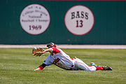 18 April 2010: Chad Hinshaw dives to his right after a fly ball to center.  Southern Illinois Salukis and the Illinois State Redbirds face off on Duffy Bass Field on the campus of Illinois State University in Normal Illinois.