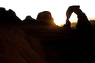 "Tourists climb to the base of Delicate Arch in Arches National Park to watch the sun rise over the rock formation. ytrew ""Delicate Arch"""