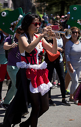 A trumpeter with the Burlesque Band of San Francisco marches through Golden Gate Park, during the 105th running of the Bay to Breakers 12k, Sunday, May 15, 2016 in San Francisco. The 7.42-mile race from San Francisco Bay to the Pacific Ocean, which attracts a field of tens of thousands of runners, from elite runners to weekend warriors, some clad in costume and some in nothing at all. (D. Ross Cameron/Bay Area News Group)