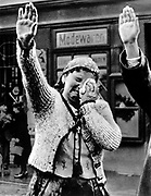 Sudeten German woman in Asch crying tears of joy when Hitler crossed the border in 1938.