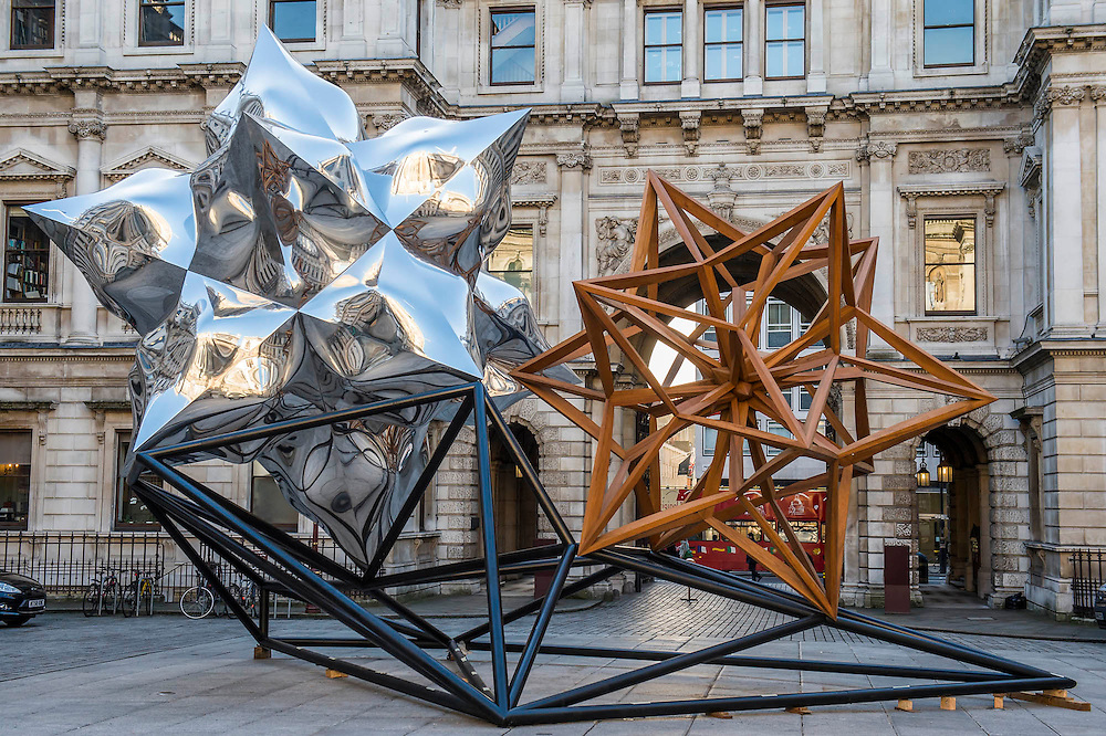 Inflated Star and Wooden Star, 2014 - a new large-scale sculpture by Frank Stella Hon RA, one of the most important living American artists (b. 1936), in the courtyard of the Royal Academy on Wednesday 18 February 2015. Standing at 7 metres tall and over 8 metres wide, it is the first time his work has been exhibited in the UK. The work will be on display until the 17 May 2015. The complex sculpture has been fabricated from aluminium and teakwood. Stella was made an Honorary Royal Academician in 1993 and his work can be found in prestigious international collections. He has been the subject of several retrospectives in the United States, Europe, and Japan, and will have a major retrospective at the Whitney Museum of American Art in New York in autumn 2015.