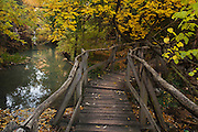 Beautiful autumn river with many waterfalls and pools