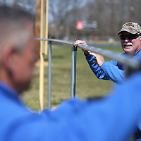 Gary McKissick, right, holds his fence top in place as Andy Loden secures the other end before they move on putting up a new outfield fence at Wesson park Tuesday in Saltillo.