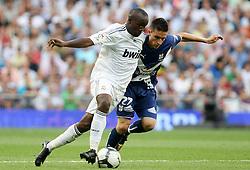 Real Madrid's Lass Diarra (l) and Tenerife's Omar during La Liga match.September 2 2009.
