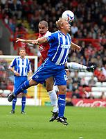 Photo: Ed Godden.<br />Bristol City v Brighton & Hove Albion. Coca Cola League 1. 02/09/2006. Scott Murray (L) and Brighton's Richard Carpenter go for the ball.