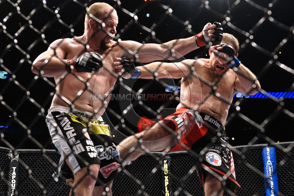 "ATLANTA, GEORGIA, SEPTEMBER 6, 2008: Tim Boetsch (left) and Mike Patt trade blows during ""UFC 88: Breakthrough"" inside Philips Arena in Atlanta, Georgia on September 6, 2008"