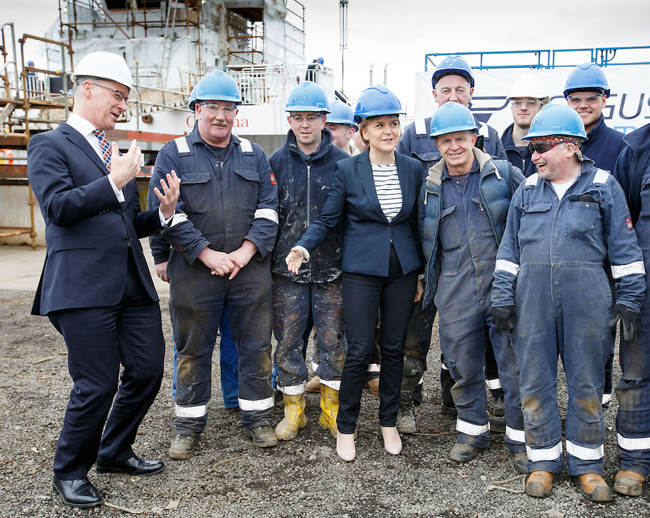 First Minister Nicola Sturgeon and Deputy First Minister John Swinney during a visit to Ferguson's shipyard in Port Glasgow – to highlight the party's record of standing up for Scottish jobs and industry. Picture Robert Perry 14th April 2016<br /> <br /> Must credit photo to Robert Perry<br /> FEE PAYABLE FOR REPRO USE<br /> FEE PAYABLE FOR ALL INTERNET USE<br /> www.robertperry.co.uk<br /> NB -This image is not to be distributed without the prior consent of the copyright holder.<br /> in using this image you agree to abide by terms and conditions as stated in this caption.<br /> All monies payable to Robert Perry<br /> <br /> (PLEASE DO NOT REMOVE THIS CAPTION)<br /> This image is intended for Editorial use (e.g. news). Any commercial or promotional use requires additional clearance. <br /> Copyright 2014 All rights protected.<br /> first use only<br /> contact details<br /> Robert Perry     <br /> 07702 631 477<br /> robertperryphotos@gmail.com<br /> no internet usage without prior consent.         <br /> Robert Perry reserves the right to pursue unauthorised use of this image . If you violate my intellectual property you may be liable for  damages, loss of income, and profits you derive from the use of this image.