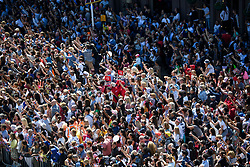 © Licensed to London News Pictures. 19/05/2018. London, UK.  Thousands of members of the public watch as Prince Harry, The Duke of Sussex and Meghan Markle, The Duchess of Sussex leave St George's Chapel in Windsor Castle following a wedding ceremony. Photo credit: LNP