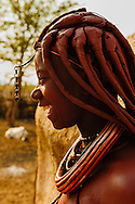 A young Himba girl laughing