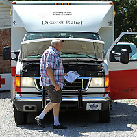 With check list in hand, Joe Lukas, Red Cross Board Member and Director of Operations Services, circles the Disaster Relief Vehicle, ERV 1138, making sure the truck is ready in case it is needed once Hurricane Florence hits the east coast.