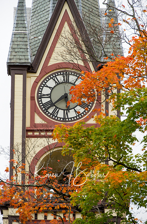 The United Baptist Churck steeple in Lakeport is shrouded with fall color on Monday morning.  (Karen Bobotas/for the Laconia Daily Sun)
