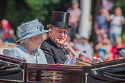 "The Queen and Prince Philip - Trooping the Colour by the Irish Guards on the Queen's Birthday Parade. The Queen's Colour is ""Trooped"" in front of Her Majesty The Queen and all the Royal Colonels.  His Royal Highness The Duke of Cambridge takes the Colonel's Review for the first time on Horse Guards Parade riding his horse Wellesley. The Irish Guards are led out by their famous wolfhound mascot Domhnall and more than one thousand Household Division soldiers perform their ceremonial duty. The Soldiers will parade in the traditional ceremonial uniforms of the Household Cavalry, Royal Horse Artillery, and Foot Guards. They are accompanied by the Household Division Bands & Corps of Drums. London 17th June 2017."