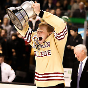 Patrick Brown #23 of the Boston College Eagles celebrates with The Beanpot following The Beanpot Championship Game at TD Garden on February 10, 2014 in Boston, Massachusetts. (Photo by Elan Kawesch)