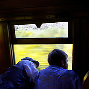 Harry Burgess, 15, (right) and his brother Jack Burgess, 12, riding on the Kingston Flyer vintage steam train at Saturday's relaunch of the historic locomotives at Fairlight near Queenstown, Central Otago, New Zealand, 29th October 2011. Photo Tim Clayton...