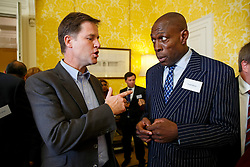 © Licensed to London News Pictures. 10/10/2014. LONDON, UK. Deputy Prime Minister Nick Clegg and Frank Bruno meeting at a reception for World Mental Health day on Friday, 10 October 2014 at Admiralty House in central London. Photo credit : Tolga Akmen/LNP