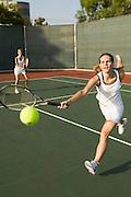 Tennis Player Reaching For Ball
