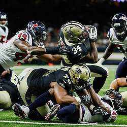Aug 26, 2017; New Orleans, LA, USA; New Orleans Saints running back Darius Victor (34) scores past Houston Texans linebacker Tony Washington Jr. (49) during the second half of a preseason game at the Mercedes-Benz Superdome. The Saints defeated the Texans 13-0. Mandatory Credit: Derick E. Hingle-USA TODAY Sports