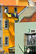 Colorful buildings on laundry day in Lisbon, Portugal.