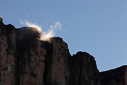 The first sunlights hits the rocks, early morning at Roraima Mountain, looking from the base camp to the top of the Tepui.