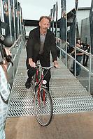 24 JUN 2000, MUENSTER/GERMANY:<br /> Jürgen Trittin, B90/Grüne, Bundesumweltminister, testet ein Fahrrad mit Elektro-Hilfsantrieb, während der Bundesdelegiertenkonferenz, Halle Münsterland<br /> IMAGE: 20000624-01/03-35<br /> KEYWORDS: Parteitag, Rad, Bike