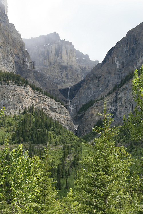 Distant waterfall cascades from hanging valley Banff National Park; Alberta, Canada.
