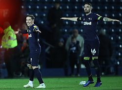 """Derby County's Harry Wilson and Scott Malone celebrates with fans after the Sky Bet Championship match at The Hawthorns, West Bromwich. PRESS ASSOCIATION Photo. Picture date: Wednesday October 24, 2018. See PA story SOCCER West Brom. Photo credit should read: Nick Potts/PA Wire. RESTRICTIONS: EDITORIAL USE ONLY No use with unauthorised audio, video, data, fixture lists, club/league logos or """"live"""" services. Online in-match use limited to 120 images, no video emulation. No use in betting, games or single club/league/player publications."""