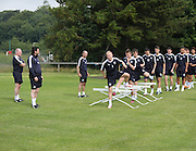 Dundee manager Paul Hartley watches as Nicky Low goes over the hurdles during Dundee pre-season training at University grounds, Riverside<br /> <br />  - &copy; David Young - www.davidyoungphoto.co.uk - email: davidyoungphoto@gmail.com