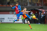 Mark Reynolds (#30 of Dundee United FC clears the ball as he is tackled by Nathan Austin (#9) of Inverness Caledonian Thistle FC during the William Hill Scottish Cup quarter final match between Dundee United and Inverness CT at Tannadice Park, Dundee, Scotland on 3 March 2019.