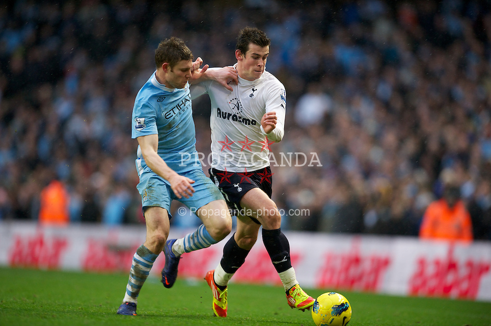 MANCHESTER, ENGLAND - Sunday, January 22, 2011: Manchester City's James Milner in action against Tottenham Hotspur's Gareth Bale during the Premiership match at the City of Manchester Stadium. (Pic by David Rawcliffe/Propaganda)