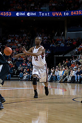 Virginia's Jamil Tucker (12) passes the ball against Wake Forest.  The Virginia Cavaliers defeated the Wake Forest Demon Decons 88-76 at the John Paul Jones Arena in Charlottesville, VA on January 21, 2007.