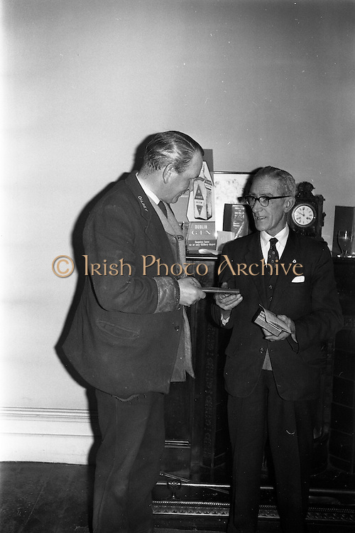 13/02/1963<br /> 02/13/1963<br /> 13 February 1963<br /> Retirement presentation at Gilbeys of Ireland Ltd., Dublin. A presentation of a cheque for £100 and a gold watch was made to Paddy Slater (65), on his retirement after 49yrs and 7 months service with the company. A sum of money was also presented by the staff. Picture shows:Staff member (left) presenting the staff collection to Mr. Slater.