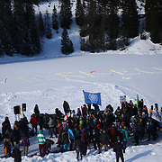 The third and last day of the Strike WEF march on Davos, 19th of January 2020, Switzerland. 'We are Rising' written in the snow. The authorities had refused perission for the march to walk on the road into Davos so many hiked across the mountains from Klosters to get there. The march is a three day protest against the World Economic Forum meeting in Davos. The activists want climate justice and think that The WEF is for the world's richest and political elite only