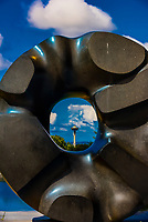"Looking at the Space Needle through the sculpture titled ""Black Sun"", created 1969 by Isaumu Noguchi; Volunteer Park, Seattle, Washington USA."