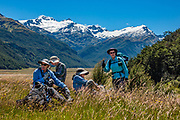 Hiking under Mount Head and Grant Glacier along Rees River on Rees Station, on the Rees-Dart Track, Otago region, South Island of New Zealand. In 5 days, we tramped the strenuous Rees-Dart Track for 39 miles plus 12.5 miles side trip to spectacular Cascade Saddle, in Mount Aspiring National Park. To license this Copyright photo, please inquire at PhotoSeek.com .