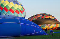Inflating the envelopes of Tracer, Firefly, and Blues Breaker for a morning launch at the Crown of Maine Balloon Fair, Presque Isle, Maine.